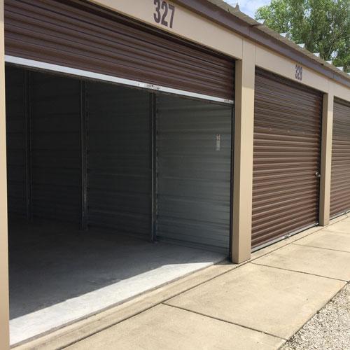 Photograph of an outdoor self storage building with one door open