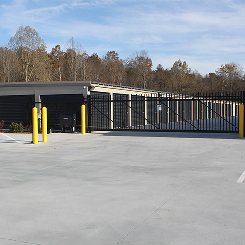 photograph of an automatic gate with pin-code access guarding a self storage facility
