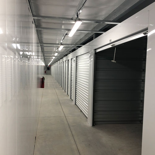 photograph of a row of indoor, climate-controlled self storage units