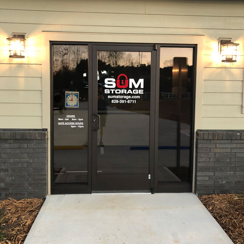 photograph of a front door to an office on the premises of a self storage building